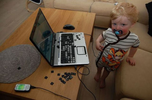 Caption This A Curious Baby A Computer